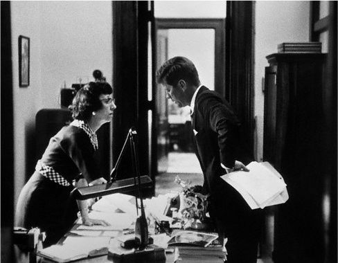 Black-and-white photograph of my aunt, Evelyn Norton Lincoln—also an author—with President John F. Kennedy, her boss. Evelyn and Kennedy lean in from opposite sides of a central desk, strewn with papers, in tight conversation. Kennedy's left hand, grasping a sheath of papers, rests on his hip. Evelyn, one hand propped on the desk looks intently at Kennedy. Evelyn was an inspiration for me as I was growing up, and then establishing myself in the world in the 1970s and 80s. Evelyn believed in big dreams, and she and my Uncle Abe encouraged me to shoot for the moon, which for me was not the terrain of politics, but rather the landscape of story. Learning to be an expert memoir editor is something my Aunt Evelyn would admire as she certainly learned how to be an expert at delivering whatever was needed whenever it was needed for the President of the United States.