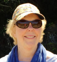 Photo of writer Sally Petersen, client of editor Lisa Dale Norton, wearing sunglasses and a cap.